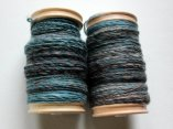 Two bobbins of 2-ply